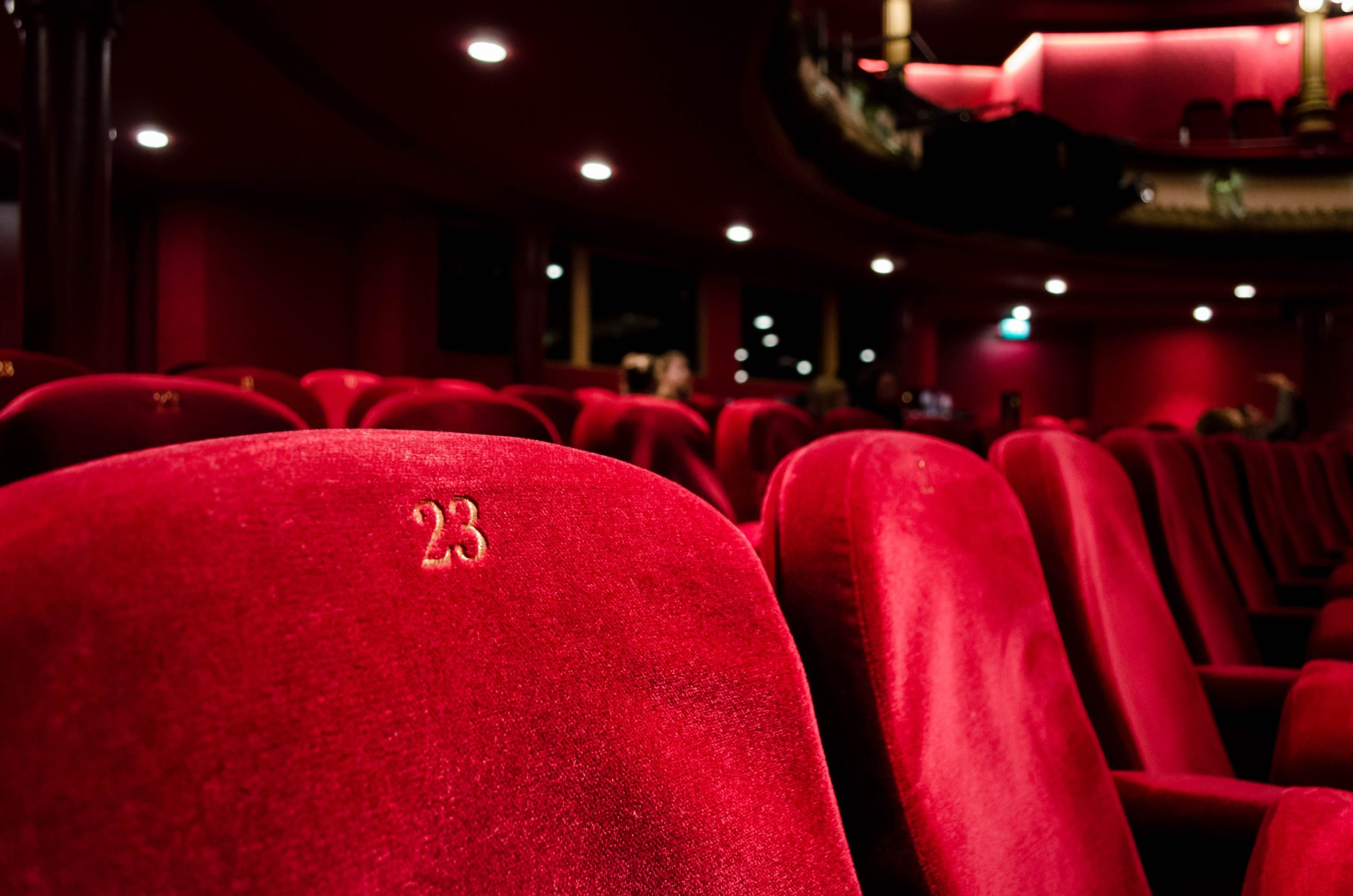 Close up image of red theatre chair. Image is used for web design only.
